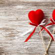 Two red hearts on wooden background. Valentines Day card. Love concept — Foto Stock