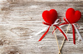 Two red hearts on wooden background. Valentines Day card. Love concept — Stock Photo