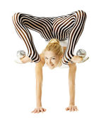 Circus gymnast woman flexible body standing on arms upside down, balancing balls on feet. Isolated white background — Foto de Stock