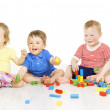 Children group playing toy blocks. Baby Kids development, isolated over white background — Stock Photo #50977489