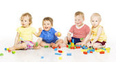 Children group playing toy blocks. Baby Kids development, isolated over white background — Stock Photo
