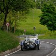 Постер, плакат: Blue Aston Martin Le Mans during 1000 Miglia