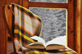 Book on a chair in winter — Stock Photo