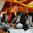 Stock Photo: Sikh offer food at 2013 Baisakhi festival in Brescia