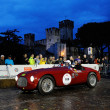 Постер, плакат: Red Ferrari 106 MM 1949 during the 1000 Miglia in Sirmione