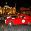 Red Fiat 508, 1938, and brown Alfa Romeo 6C 2500, 1940, drives by Piazza San Pietro the 1000 Miglia — Stock Photo #29427819