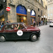 Red and black Fiat 1100 TV, 1957, drives in Florence during 1000 Miglia — Stock Photo