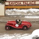 Classic car taking part to the 2014 WinteRace regularity race in Italian Dolomiti — Stock Photo