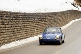 Classic car taking part to the 2014 WinteRace regularity race in Italian Dolomiti — Stock Photo