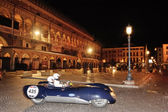 A blue Lotus Mk IX Climax takes part to the 1000 Miglia classic car race on May 15, 2014 in Piazza delle Erbe, Padova. The car was built in 1937 — Stock Photo