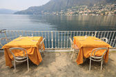 Tables on the lakefront in Torno — Stock Photo