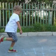 Stock Video: Older brother teaches junior to play hopscotch
