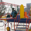 Boy playing on the playground — Stock Video #16184683