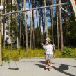 Boy playing on the playground — Stock Video #16191803