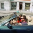 Happy young couple in a convertible car. — Stock Video #16875589