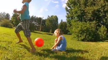 Two brothers playing soccer in the park — Stock Video