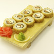 Traditional Japanese sushi on wooden plate — Stockfoto #19068135