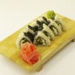 Traditional Japanese sushi on wooden plate — Foto de stock #19068137