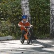 Little boy in a helmet riding on a bike. Back view — Video