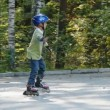 Royalty-Free Stock  : Young boy learning to ride on rollerskates