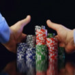 Hands taking poker chips after winning on black background — Stock Video