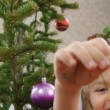 Stock Video: Children decorate a Christmas tree