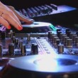 Female dj mixes the track at a party — Stock Video