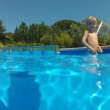 Little boy come into pool — Stock Video