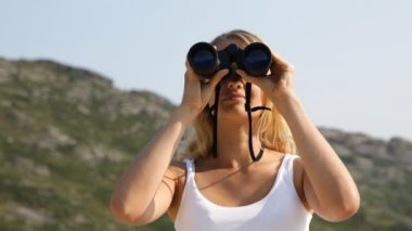 Woman looking through binoculars — Stock Video