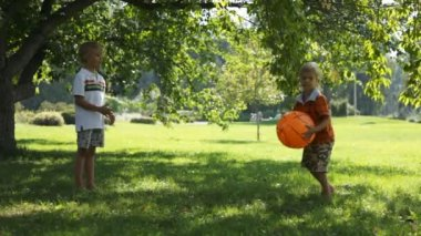 Two young boys playing with a ball — Stock Video