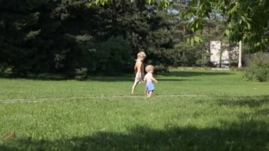 Two young boys walking in the park — Stock Video