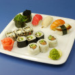 Sushi set on blue background — Stock Photo #37100597