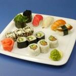 Sushi set on blue background — Stock Photo