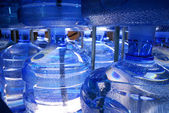 Producing big plastic bottles of water. — Stock Photo