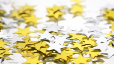 Silver and Gold confetti stars on a white background — Stock Video