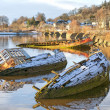Bowling harbour sunken boats — Stock Photo