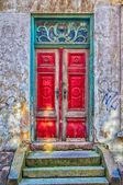 Red Door Green Frame — Stock Photo
