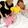 Happy family playing - Stockfoto