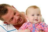 Leende far och baby — Stockfoto