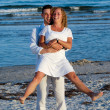 Happy young couple at beach — Stock Photo #13187881