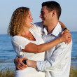 Happy young couple at beach — Stock Photo