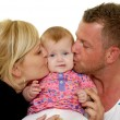Mother and father are kissing baby — Stock Photo #39607463