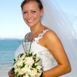 Happy smiling wedding bride with bouquet. — Stock Photo #43669167