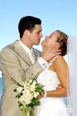 Happy wedding couple smiling — Stock Photo