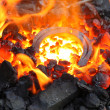 Horseshoe in embers — Stock Photo