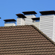 Chimneys on roof — Stock Photo