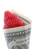 Strawberry in one dollar — Stock Photo