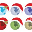 Globes with Santa Claus hat — Stock Vector