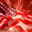 Fireworks over United States flag — Stock Photo