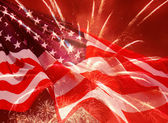 Fireworks over United States flag — Stock Photo